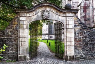 gates in a churchyard opening to a courtyard