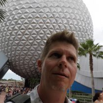 Dennis Cheatham at Epcot center making a silly face.
